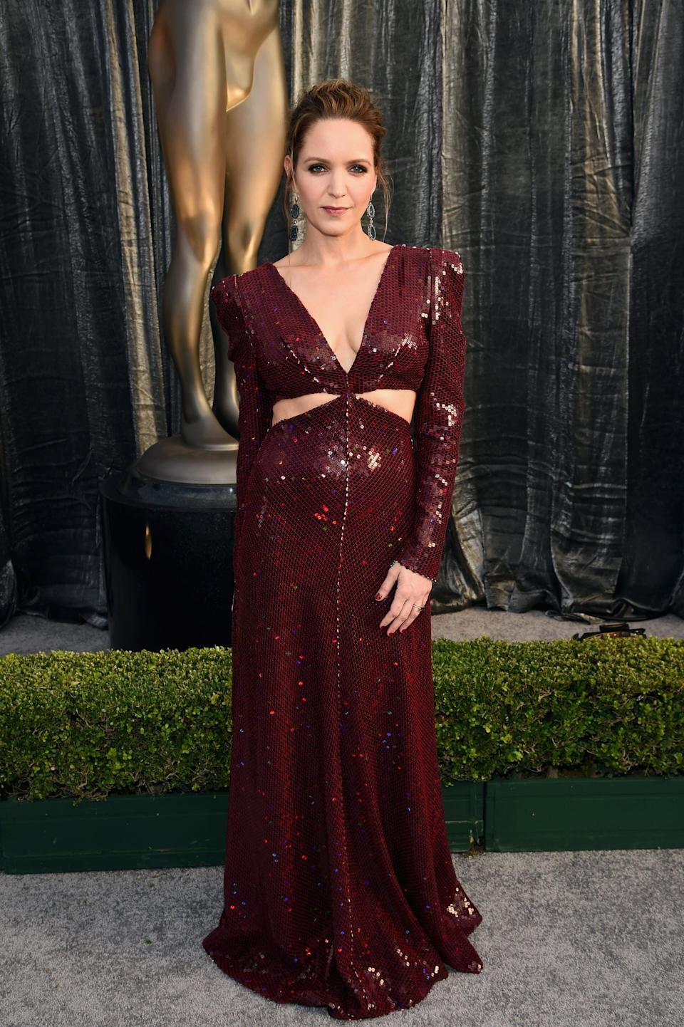 <p>Wearing a Markarian gown.</p>