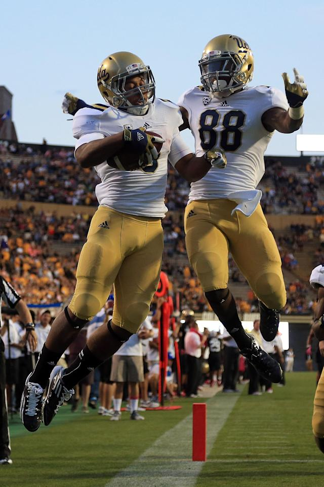 BOULDER, CO - SEPTEMBER 29: Running back Jordon James #6 of the UCLA Bruins celebrates his 25 yard touchdown run against the Colorado Buffaloes with wide receiver Jerry Rice Jr. #88 of the UCLA Bruins in the fourth quarter at Folsom Field on September 29, 2012 in Boulder, Colorado. UCLA defeated Colorado 42-14. (Photo by Doug Pensinger/Getty Images)