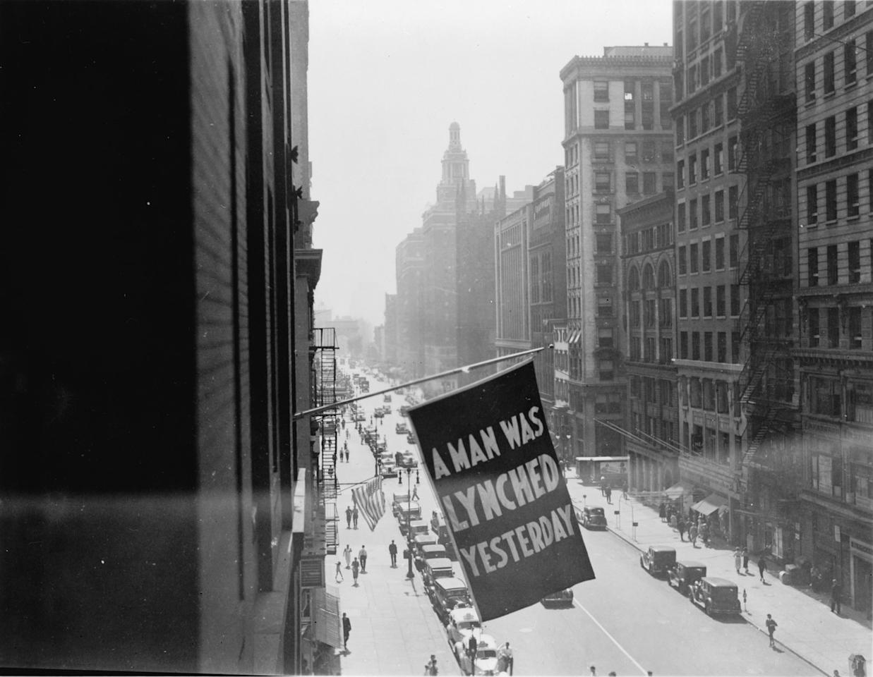 <p>A flag flies outside the offices of the NAACP on Fifth Avenue, announcing that another lynching had taken place in America. (Visual Materials from the NAACP Records, Prints and Photographs Division, Visual Materials from the NAACP Records, Library of Congress, Washington, D.C.) </p>