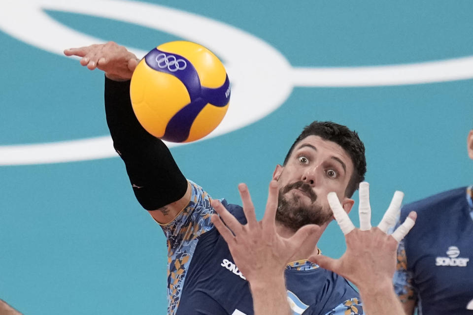 Argentina's Facundo Conte spikes a ball during a men's volleyball preliminary round pool B match against the United States, at the 2020 Summer Olympics, Sunday, Aug. 1, 2021, in Tokyo, Japan. (AP Photo/Manu Fernandez)