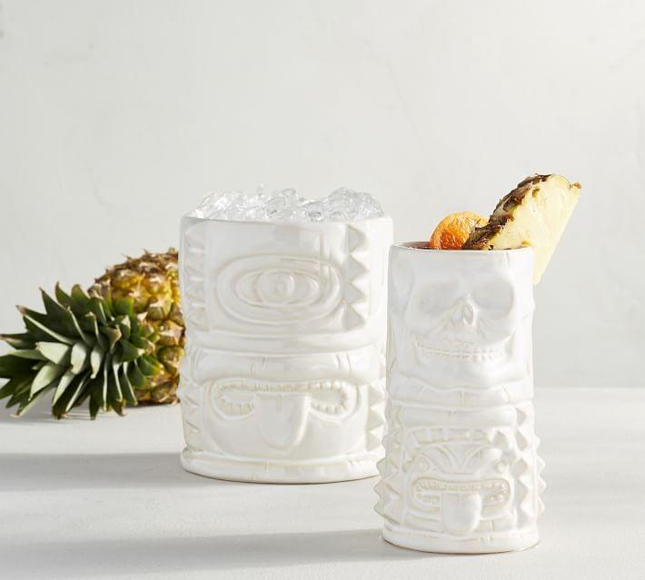 """<p>Forget solo cups - the stoneware <a href=""""https://www.popsugar.com/buy/Tiki-Ceramic-Drinkware-Collection-476704?p_name=Tiki%20Ceramic%20Drinkware%20Collection&retailer=potterybarn.com&pid=476704&price=17&evar1=casa%3Auk&evar9=46461332&evar98=https%3A%2F%2Fwww.popsugar.com%2Fhome%2Fphoto-gallery%2F46461332%2Fimage%2F46461340%2FTiki-Ceramic-Drinkware-Collection&list1=halloween%2Challoween%20decor&prop13=api&pdata=1"""" rel=""""nofollow"""" data-shoppable-link=""""1"""" target=""""_blank"""" class=""""ga-track"""" data-ga-category=""""Related"""" data-ga-label=""""http://www.potterybarn.com/products/tiki-ceramic-drinkware-collection/?pkey=choliday-all-halloween-decor&amp;isx=0.0"""" data-ga-action=""""In-Line Links"""">Tiki Ceramic Drinkware Collection</a> ($17-$40), which includes <a href=""""https://www.popsugar.com/buy/ice-bucket-476705?p_name=an%20ice%20bucket&retailer=potterybarn.com&pid=476705&price=40&evar1=casa%3Auk&evar9=46461332&evar98=https%3A%2F%2Fwww.popsugar.com%2Fhome%2Fphoto-gallery%2F46461332%2Fimage%2F46461340%2FTiki-Ceramic-Drinkware-Collection&list1=halloween%2Challoween%20decor&prop13=api&pdata=1"""" rel=""""nofollow"""" data-shoppable-link=""""1"""" target=""""_blank"""" class=""""ga-track"""" data-ga-category=""""Related"""" data-ga-label=""""https://www.potterybarn.com/products/tiki-ceramic-drinkware-collection/?pkey=choliday-all-halloween-decor&amp;isx=0.0"""" data-ga-action=""""In-Line Links"""">an ice bucket</a> ($40) and <a href=""""https://www.popsugar.com/buy/ice-bucket-476705?p_name=an%20ice%20bucket&retailer=potterybarn.com&pid=476705&price=40&evar1=casa%3Auk&evar9=46461332&evar98=https%3A%2F%2Fwww.popsugar.com%2Fhome%2Fphoto-gallery%2F46461332%2Fimage%2F46461340%2FTiki-Ceramic-Drinkware-Collection&list1=halloween%2Challoween%20decor&prop13=api&pdata=1"""" rel=""""nofollow"""" data-shoppable-link=""""1"""" target=""""_blank"""" class=""""ga-track"""" data-ga-category=""""Related"""" data-ga-label=""""https://www.potterybarn.com/products/tiki-ceramic-drinkware-collection/?pkey=choliday-all-halloween-decor&amp;isx=0.0"""" data-ga-action=""""In-Line Links"""">a tumbler</a> ($"""