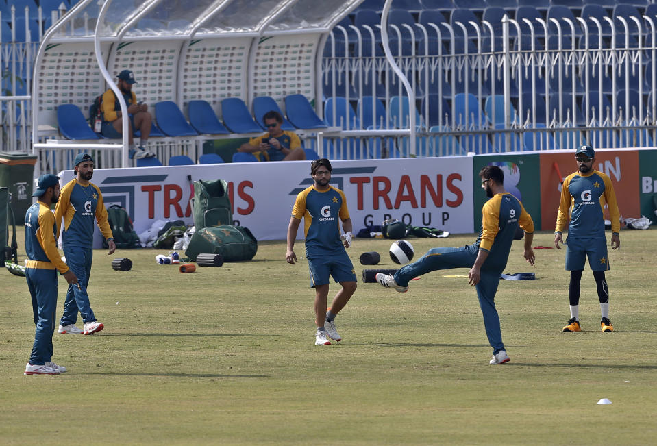 Pakistan player Babar Azam, right, Imad Wasim, second right, Imam-ul-Haq, center, and others play soccer prior to practice session at the Pindi Cricket Stadium, in Rawalpindi, Pakistan, Thursday, Oct. 29, 2020. The Zimbabwe cricket team is in Pakistan to play three ODIs and three Twenty20 International match series, beginning with the first ODI on Friday. (AP Photo/Anjum Naveed)