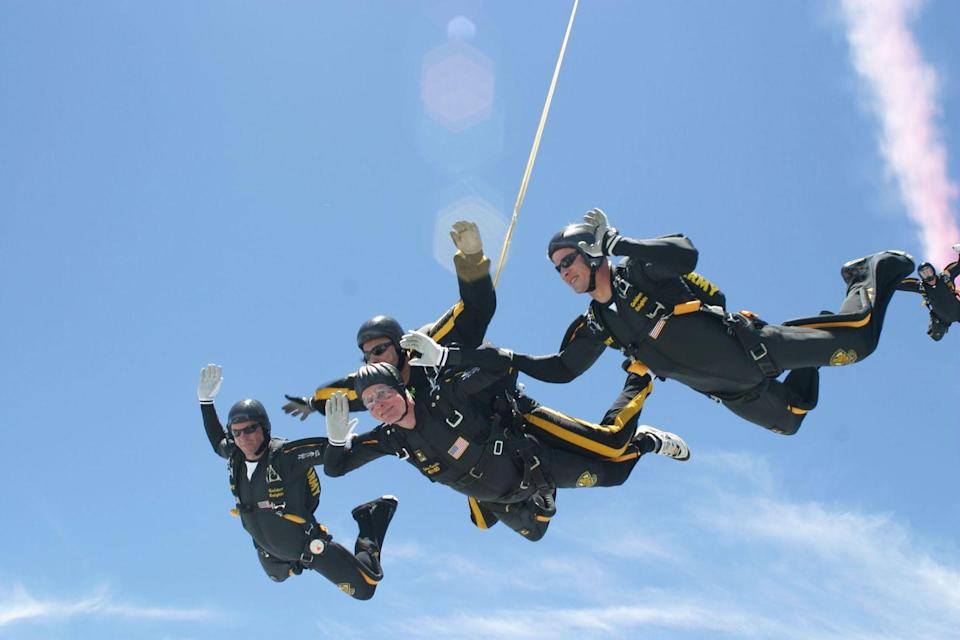 <p>President George H. W. Bush celebrated his 80th birthday by jumping out of an airplane. That's him in the middle flying tandem. </p>