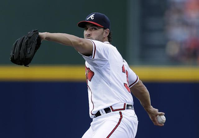 Atlanta Braves starting pitcher Brandon Beachy (37) faces a Colorado Rockies batter in the first inning of a baseball game in Atlanta, Monday, July 29, 2013. Beachy was making his first start of the season after having elbow surgery. (AP Photo/John Bazemore)