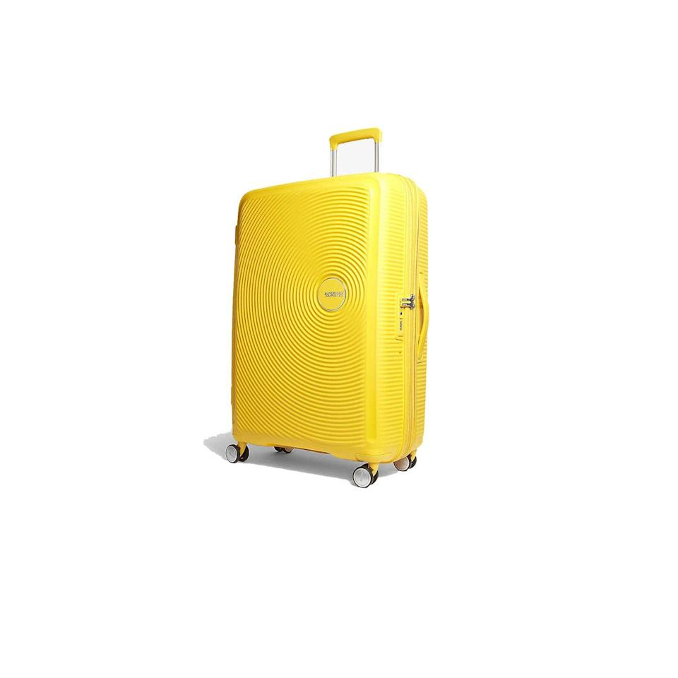 """<p><a class=""""link rapid-noclick-resp"""" href=""""https://go.redirectingat.com?id=127X1599956&url=https%3A%2F%2Fwww.selfridges.com%2FGB%2Fen%2Fcat%2Famerican-tourister-soundbox-expandable-four-wheel-suitcase-77cm_193-86035606-88474%2F&sref=https%3A%2F%2Fwww.cosmopolitan.com%2Fuk%2Fentertainment%2Ftravel%2Fg28101108%2Flarge-suitcase%2F"""" rel=""""nofollow noopener"""" target=""""_blank"""" data-ylk=""""slk:BUY NOW"""">BUY NOW</a> <strong>£150</strong></p><p>Go loud and proud with a Gen-Z yellow suitcase that will give your Insta followers luggage envy. American Tourister's Soundbox 77cm luggage comes in a few colours but it was this sunny hue that caught our eye. It's expandable so you can pack all those souvenirs in too.</p>"""