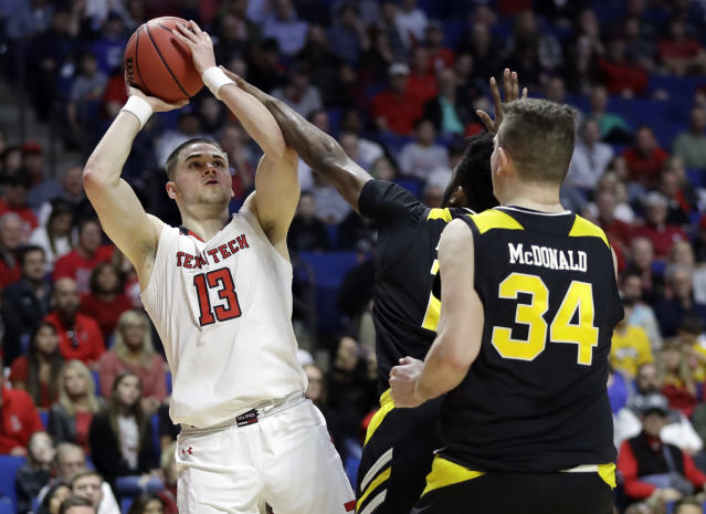 Texas Tech's Matt Mooney (13) shoots over Northern Kentucky's Drew McDonald (34) during the second half of a first round men's college basketball game in the NCAA Tournament Friday, March 22, 2019, in Tulsa, Okla. Texas Tech won 72-57. (AP Photo/Jeff Roberson)
