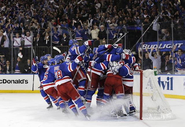 The New York Rangers celebrate after beating the Montreal Canadiens 1-0 in Game 6 of the NHL hockey Stanley Cup playoffs Eastern Conference finals, Thursday, May 29, 2014, in New York. The Rangers advance to the Stanley Cup Final. (AP Photo/Julie Jacobson)