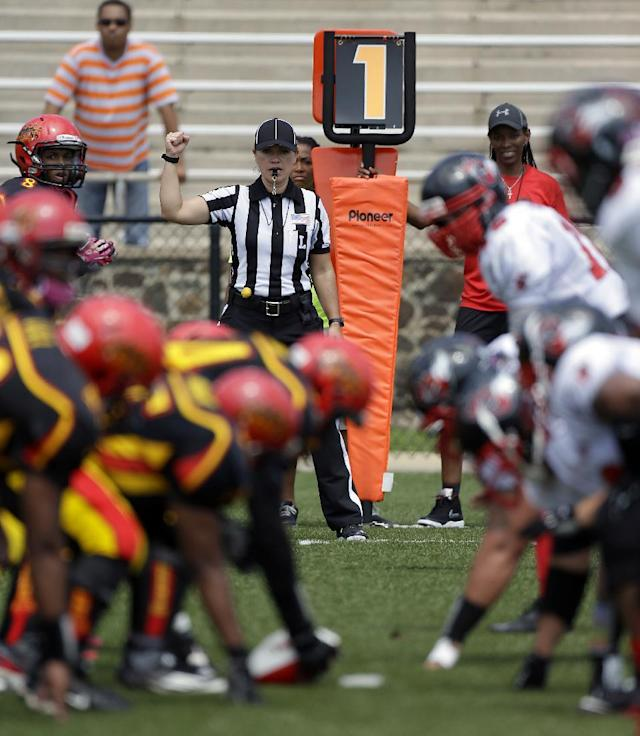 IMAGE DISTRIBUTED FOR NATIONAL FOOTBALL LEAGUE - Line Judge Catherine Conti signals from the sidelines at the Legacy Bowl Women's Football Championship, on Friday July 25, 2014 at District Three Stadium in Rock Hill, S.C. The Carolina Queens beat the Minnesota Vixens 28-22. (Bob Leverone/AP Images for National Football League)