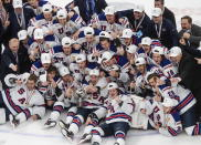 The U.S. team celebrates a win over Canada in the title game in the IIHF World Junior Hockey Championship, Tuesday, Jan. 5, 2021, in Edmonton, Alberta. (Jason Franson/The Canadian Press via AP)