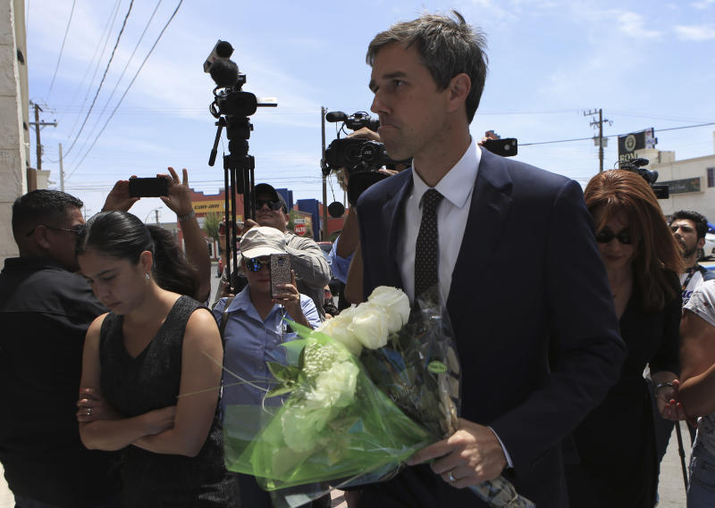"""Democratic presidential candidate Beto O'Rourke arrives with flowers to the Perches funeral home in Ciudad Juarez, Mexico, Thursday, Aug. 8, 2019, to attend a service for Ivan Filiberto Manzano, one of the 22 people killed in a shooting at a Walmart in El Paso. The former El Paso congressman said he came to the border city """"to remind the world that we are a binational community."""" (AP Photo/Christian Chavez)"""