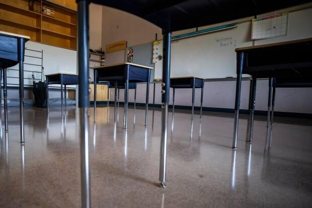Empty desks spaced apart in a classroom at Bridgeview Elementary in Surrey, British Columbia on Wednesday, Aug. 26, 2020, as teachers prepared for a school year unlike any other.