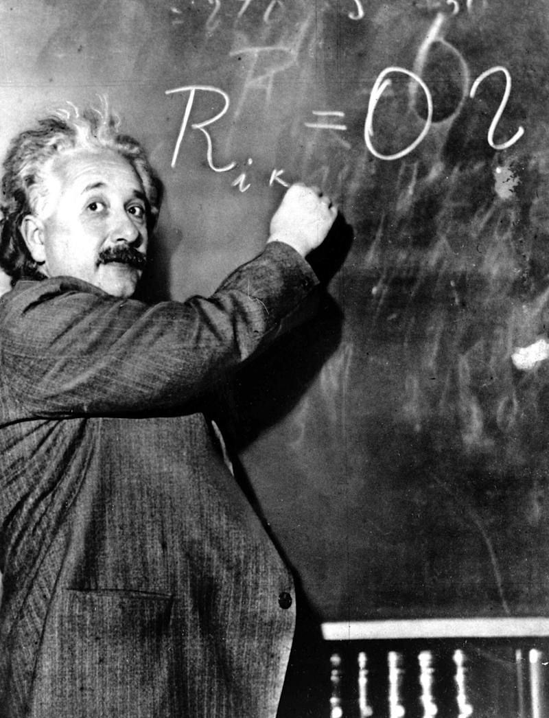 Albert Einstein writes out an equation for the density of the Milky Way on the blackboard at the Mount Wilson Observatory in Pasadena, California, on Jan. 14, 1931.