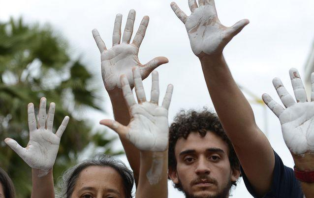 HANDS UP: Demonstrators attend an anti-government protest in Fortaleza, Brazil, on Friday. Picture: REUTERS