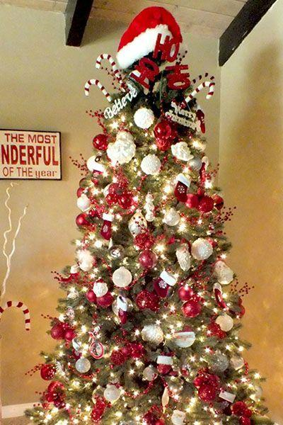 """<p>Santa just might leave some extra presents for you and your family if you steal these decorations and dress your tree up like him.</p><p><strong><em><strong>Get the tutorial at </strong><strong><a href=""""http://www.twosisterscrafting.com/santa-christmas-tree/"""" rel=""""nofollow noopener"""" target=""""_blank"""" data-ylk=""""slk:Two Sisters Crafting."""" class=""""link rapid-noclick-resp"""">Two Sisters Crafting.</a></strong></em></strong></p><p><a class=""""link rapid-noclick-resp"""" href=""""https://www.amazon.com/Beistle-20731-Velvet-Santa-Plush/dp/B0019I3J4G?tag=syn-yahoo-20&ascsubtag=%5Bartid%7C10070.g.2025%5Bsrc%7Cyahoo-us"""" rel=""""nofollow noopener"""" target=""""_blank"""" data-ylk=""""slk:BUY SANTA HAT"""">BUY SANTA HAT</a></p>"""