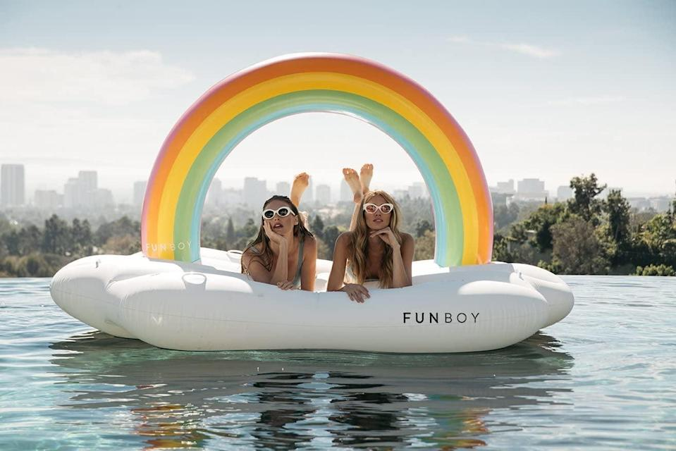 <p>Somewhere over the rainbow is this <span>Funboy Giant Inflatable Rainbow Cloud Daybed Pool Float</span> ($139).</p>