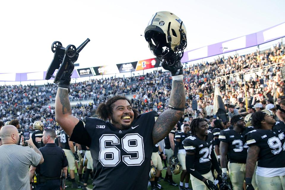 Purdue offensive lineman Greg Long (69) hoists the Cannon Trophy as Purdue celebrates defeating Illinois, 13-9, Saturday, Sept. 25, 2021 at Ross-Ade Stadium in West Lafayette, Ind.