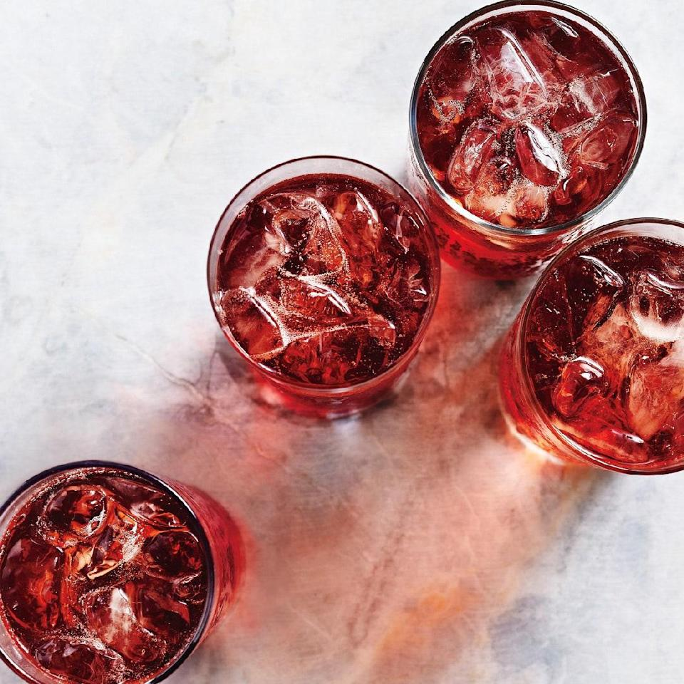 """In this bittersweet twist on the Negroni, Campari meets sweet vermouth, a good pour of rum, and sparkling wine for a little festive fizz. <a href=""""https://www.epicurious.com/recipes/food/views/evening-in-kingston-51193060?mbid=synd_yahoo_rss"""" rel=""""nofollow noopener"""" target=""""_blank"""" data-ylk=""""slk:See recipe."""" class=""""link rapid-noclick-resp"""">See recipe.</a>"""