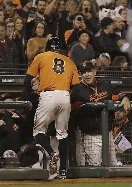 San Francisco Giants' Hunter Pence (8) is congratulated by manager Bruce Bochy, right, after hitting a solo home run off of San Diego Padres pitcher Burch Smith during the third inning of a baseball game in San Francisco, Friday, Sept. 27, 2013. (AP Photo/Jeff Chiu)