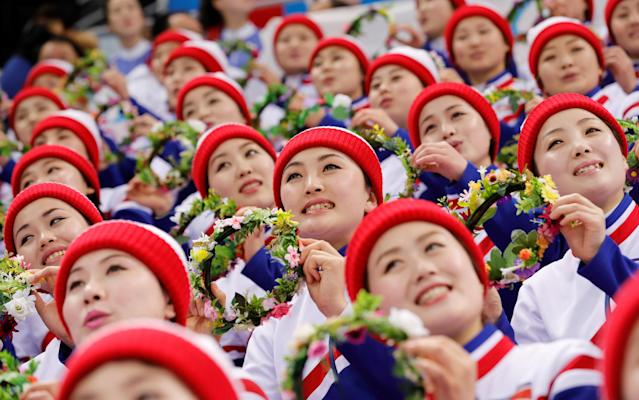 FILE PHOTO: Ice Hockey Pyeongchang 2018 Winter Olympics Men's Preliminary Round Match - Czech Republic v South Korea - Gangneung Hockey Centre, Gangneung, South Korea February 15, 2018 - North Korean cheerleaders attend the Czech Republic vs South Korea game. REUTERS/Kim Kyung-Hoon/File Photo