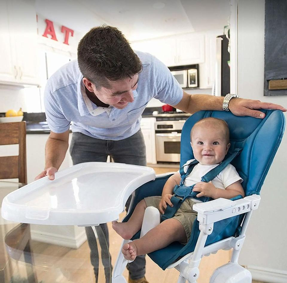 """It comes with a removable swing-open tray that's dishwasher-friendly, so you can easily clean up after your little one eats spaghetti or mashed peas.<br /><br /><strong>Promising review:</strong>""""This is a great space saving and money saving high chair. The super modern design and sleek design make it so that the chair isn't an eyesore. It also doesn't take up much space and is a great option for someone with a small dining area or living in an apartment<strong>. The setup was very simple and because there is no fabric, cleanup is a breeze. There is very little room for food to fall between cracks, but if it does simply unhook the seat cover and wipe it up.</strong>So simple and easy to keep clean. The plastic tray cover is also a great addition. All in all, I'm glad I got this chair and decided against other super expensive options. I would definitely recommend it."""" —<a href=""""https://amzn.to/3tJa6av"""" target=""""_blank"""" rel=""""nofollow noopener noreferrer"""" data-skimlinks-tracking=""""5189597"""" data-vars-affiliate=""""Amazon"""" data-vars-href=""""https://www.amazon.com/gp/customer-reviews/R1AVNYIXUDGDMH?tag=bfheather-20&ascsubtag=5189597%2C10%2C44%2Cmobile_web%2C0%2C0%2C160753"""" data-vars-keywords=""""cleaning"""" data-vars-link-id=""""160753"""" data-vars-price="""""""" data-vars-product-id=""""15996792"""" data-vars-retailers=""""Amazon"""">chocaholic<br /><br /></a><a href=""""https://amzn.to/3eGE8Yf"""" target=""""_blank"""" rel=""""noopener noreferrer""""><strong>Get it from Amazon for$199.99(available in five colors).</strong></a>"""