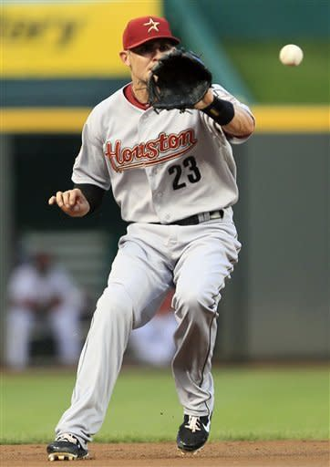 Houston Astros shortstop Tyler Greene fields a ground ball hit by Cincinnati Reds' Wilson Valdez in the second inning of a baseball game, Friday, Sept. 7, 2012, in Cincinnati. Greene threw Valez out at first. (AP Photo/Al Behrman)