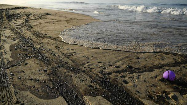 PHOTO: Oil is seen on the beach in Huntington Beach, California, Oct. 3, 2021, after a pipeline breach. (Patrick T. Fallon/AFP via Getty Images)