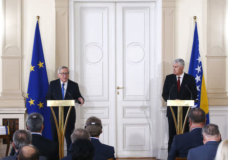 European Commision President Jean-Claude Juncker (L) and Bosnian Tripartite presidency chairman Dragan Covic speak during the official ceremony of answers to the European Commission's Questionnaire in Sarajevo, Bosnia and Herzegovina, February 28, 2018. REUTERS/Dado Ruvic