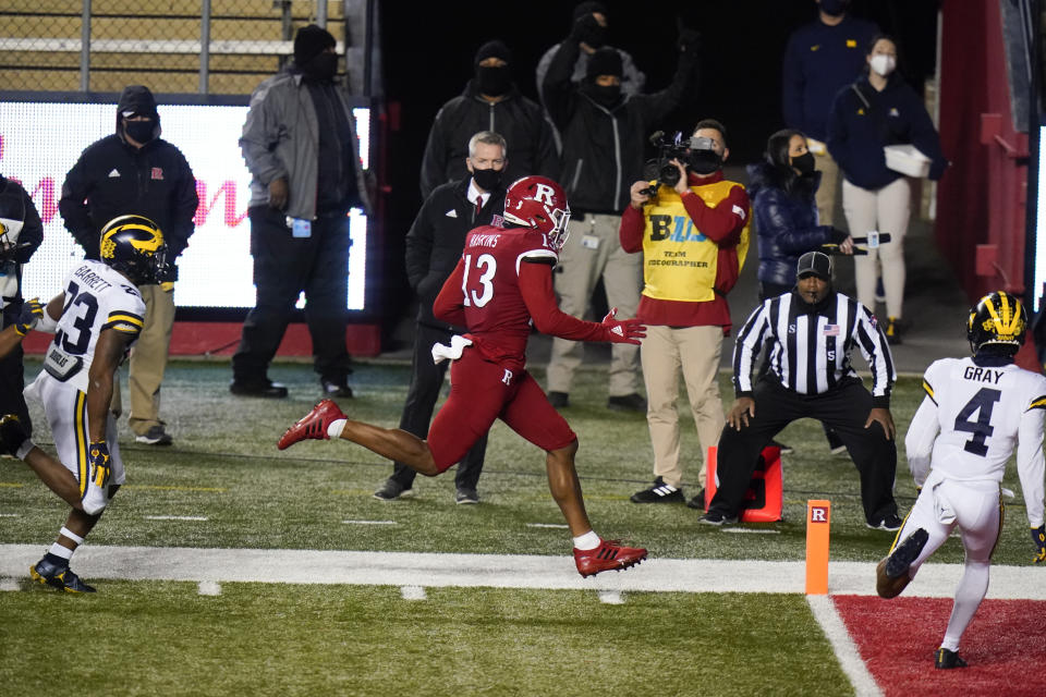 Rutgers' Jovani Haskins (13) scores a touchdown during the second overtime of an NCAA college football game Saturday, Nov. 21, 2020, in Piscataway, N.J. Michigan won 48-42. (AP Photo/Frank Franklin II)
