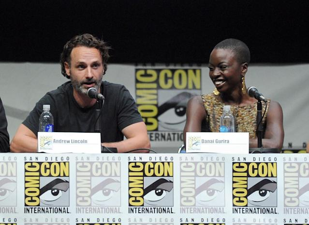 "Andrew Lincoln and Danai Gurira speak onstage at AMC's ""The Walking Dead"" panel during Comic-Con International 2013 at San Diego Convention Center on July 19, 2013 in San Diego, California."
