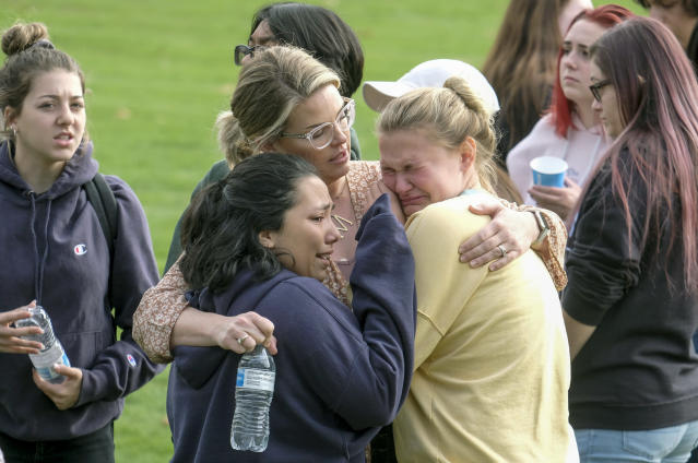 Students are comforted as they wait to be reunited with their parents following a shooting at Saugus High School that injured several people, Nov. 14, 2019, in Santa Clarita, Calif. (Photo: Ringo H.W. Chiu/AP)