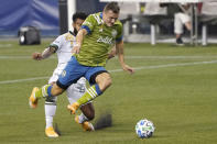 Seattle Sounders forward Jordan Morris gets in front of Portland Timbers midfielder Eryk Williamson to keep control of the ball during the first half of an MLS soccer match, Sunday, Sept. 6, 2020, in Seattle. (AP Photo/Ted S. Warren)