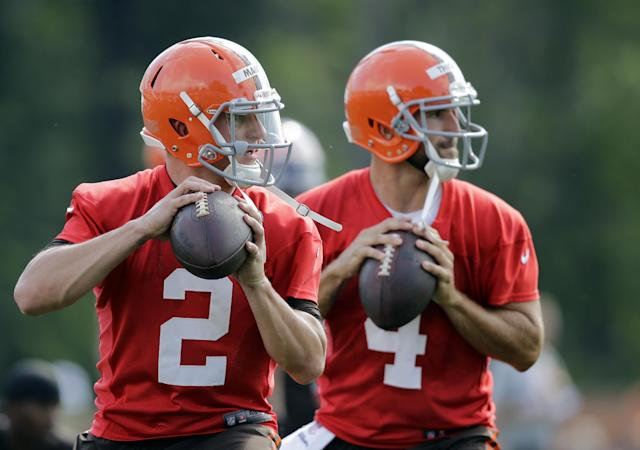 Cleveland Browns quarterback Johnny Manziel (2) drops to pass with Tyler Thigpen (4) during the first practice at the NFL football team's training camp in Berea, Ohio Saturday, July 26, 2014. (AP Photo)