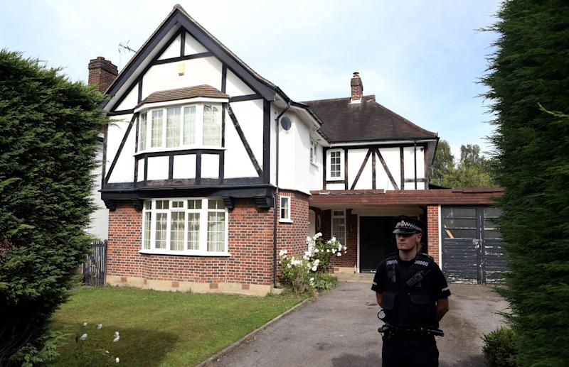 Police on Thursday Sept. 6, 2012 stand outside the home of Saad al-Hilli in Claygate, Surrey, who has been named by French media as one of the members of a British family who was shot dead by a gunman in the French Alps. (AP Photo/Steve Parsons/PA) UNITED KINGDOM OUT NO SALES NO ARCHIVE