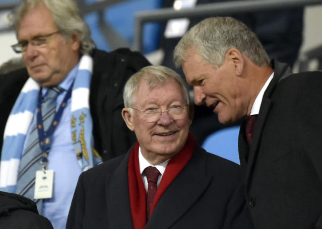 Former Manchester United manager Alex Ferguson, center, speaks with former Manchester United chief executive David Gill before the English Premier League soccer match between Manchester City and Manchester United at Etihad stadium in Manchester, England, Saturday, Dec. 7, 2019. (AP Photo/Rui Vieira)
