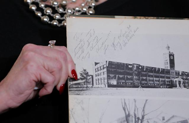 Beverly Nelson displays a page from her high school year book allegedly signed by Roy Moore. (Photo: Lucas Jackson/Reuters)