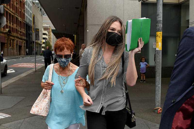 Monica Elizabeth Young (right) is seen leaving the John Madison Tower Courts, in Sydney.