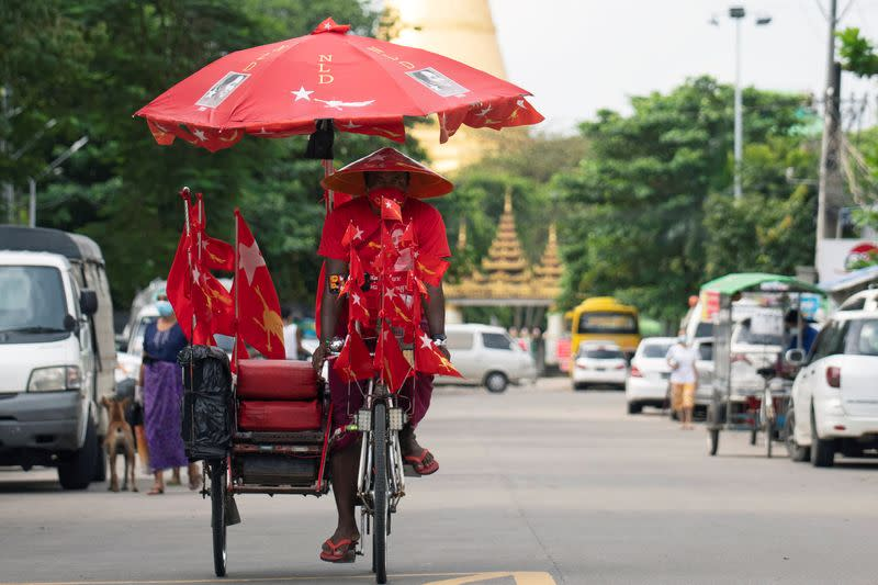 Myanmar's trishaws turn campaigners as virus curbs canvassing