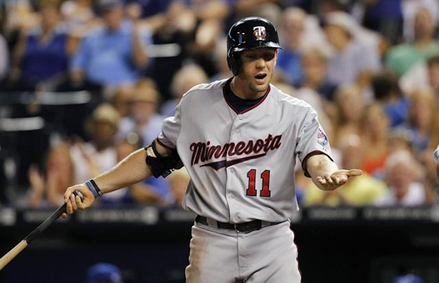 Minnesota Twins' Clete Thomas reacts after striking out in the sixth inning of a baseball game against the Kansas City Royals at Kauffman Stadium in Kansas City, Mo., Wednesday, Aug. 7, 2013. (AP Photo/Colin E. Braley)