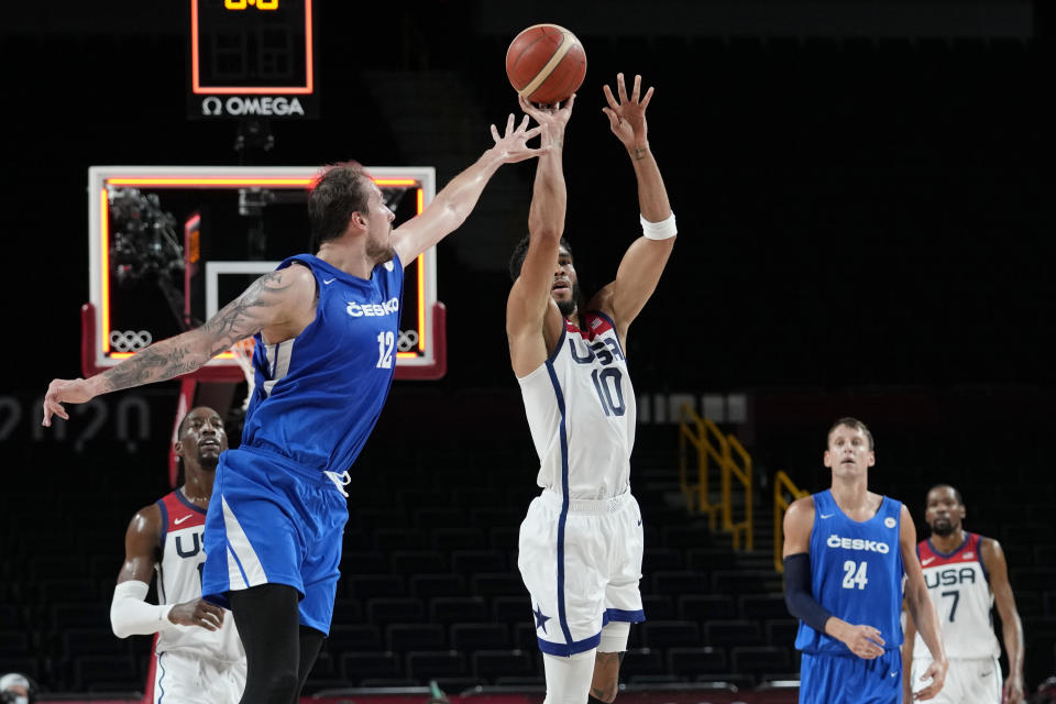 United States's Jayson Tatum (10) shoots against Czech Republic's Ondrej Balvin (12) during a men's basketball preliminary round game at the 2020 Summer Olympics, Saturday, July 31, 2021, in Saitama, Japan. (AP Photo/Eric Gay)
