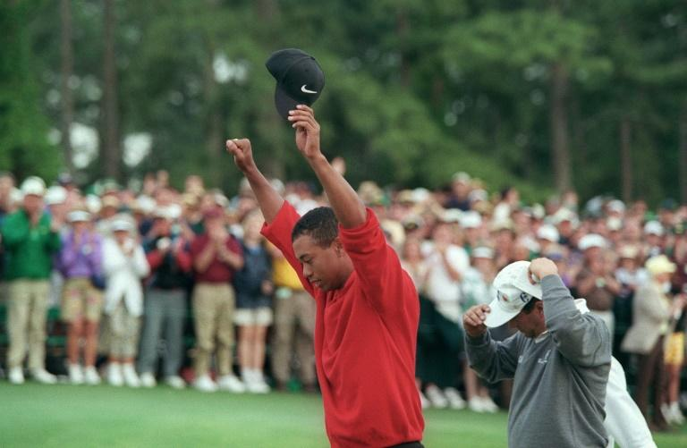 Tiger Woods raises his arms in victory after winning the 1997 Masters tournament, a turning point for the sport, the man and even the course