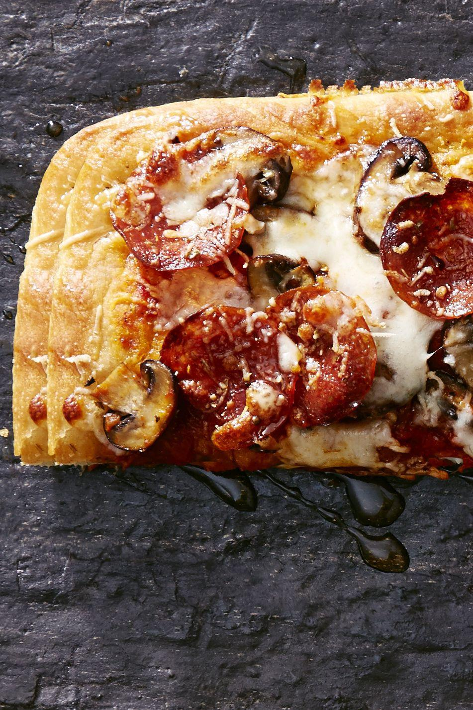 """<p>Chili flakes bring the heat, but a slight drizzle of honey brings a subtle sweetness that takes this pie up a notch.</p><p><a href=""""https://www.goodhousekeeping.com/food-recipes/party-ideas/a36233/sweet-and-spicy-pepperoni-mushroom-pizza/"""" rel=""""nofollow noopener"""" target=""""_blank"""" data-ylk=""""slk:Get the recipe for Sweet and Spicy Pepperoni-Mushroom Pizza »"""" class=""""link rapid-noclick-resp""""><em>Get the recipe for Sweet and Spicy Pepperoni-Mushroom Pizza »</em></a></p>"""