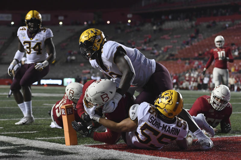 Rutgers running back Kay'Ron Adams (22) scores a touchdown as Minnesota linebacker Mariano Sori-Marin (55) defends during the second half of an NCAA college football game Saturday, Oct. 19, 2019, in Piscataway, N.J. (AP Photo/Sarah Stier)