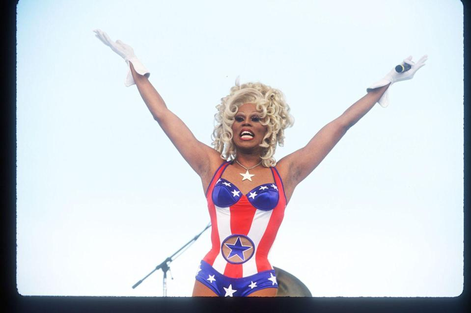<p>RuPaul sported this super patriotic one-piece look at the Gay Rights March in April 1993. </p>