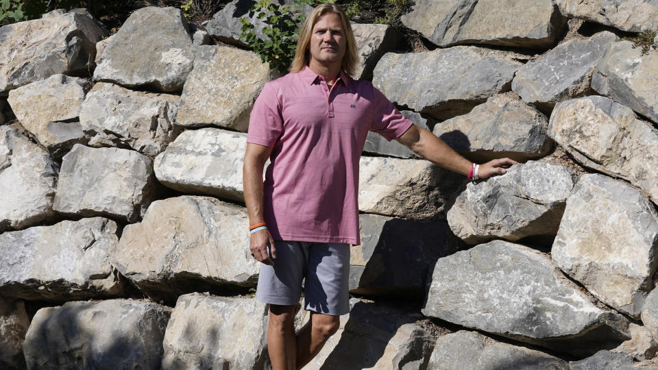 """David Stringham stands for a portrait Monday, Aug. 23, 2021, in Provo, Utah. Stringham says undergoing a procedure for shoulder and elbow pain at a local clinic in 2018 was """"the worst decision of my life"""" and left him in more pain. Since then, a neurologist has told Stringham he probably suffered nerve damage at the places where he was injected. (AP Photo/Rick Bowmer)"""