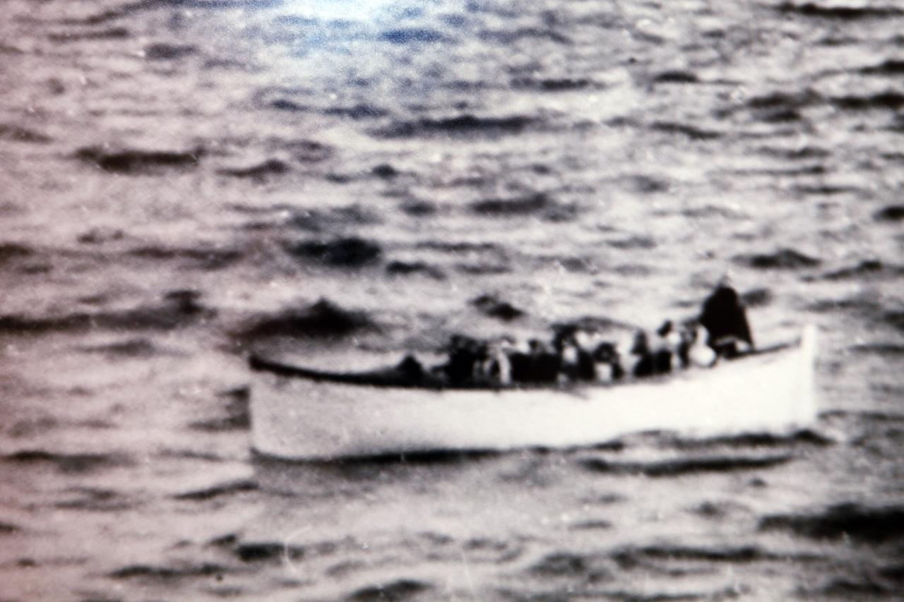 """This April 15, 1912 photo on display in the Molly Brown House Museum in Denver shows a life boat which rescued Molly Brown from the sinking Titanic. A few blocks from Colorado's state Capitol _ over 1700 miles from the Atlantic Ocean and a mile above sea level _ is a museum dedicated to a woman eclipsed by legend following the sinking of the Titantic. The """"unsinkable Molly Brown"""" moved into this stone Victorian home after she and her husband struck it rich at a gold mine in Colorado's mountains, nearly 20 years before she boarded the Titanic because it was the first boat she could get back home to visit her ailing grandson. (AP Photo/Ed Andrieski)"""