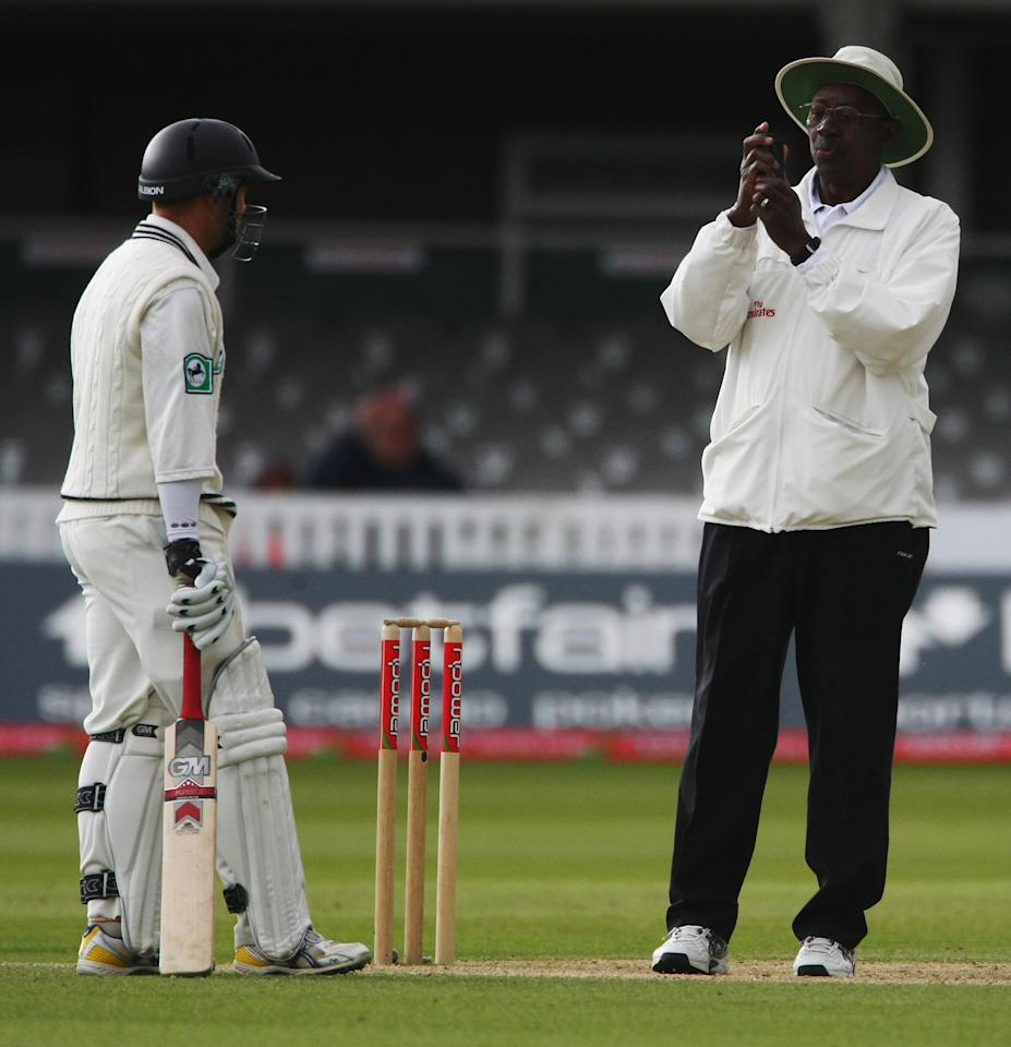 LONDON - MAY 19:  Umpire Steve Bucknor checks his meter before offering bad light to the New Zealand batsmen during the fifth day of the 1st npower Test Match between England and New Zealand at Lord's on May 19, 2008 in London, England.  (Photo by Clive Rose/Getty Images)