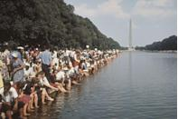 <p>The weather that day was in the low-80s, so overheated crowds cooled their feet in the Lincoln Memorial Reflecting Pool. </p>