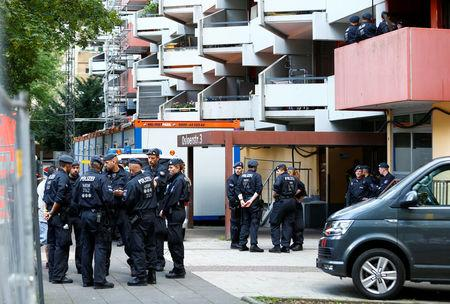 "Police waits outside the apartment of 29-year-old Sief Allah H., in Cologne, Germany, June 15, 2018, a Tunisian man who was detained on June 13, 2018, suspected of planning an Islamist-motivated attack and the manufacturing of a ""biological weapon"" using ricin.     REUTERS/Thilo Schmuelgen"