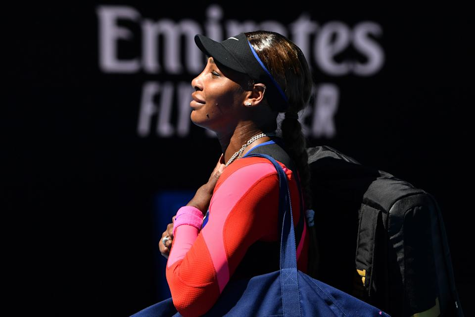 Serena Williams of the US reacts after losing to Japan's Naomi Osaka in their women's singles semi-final match on day eleven of the Australian Open tennis tournament in Melbourne on February 18, 2021. (Photo by Paul CROCK / AFP) / -- IMAGE RESTRICTED TO EDITORIAL USE - STRICTLY NO COMMERCIAL USE -- (Photo by PAUL CROCK/AFP via Getty Images)