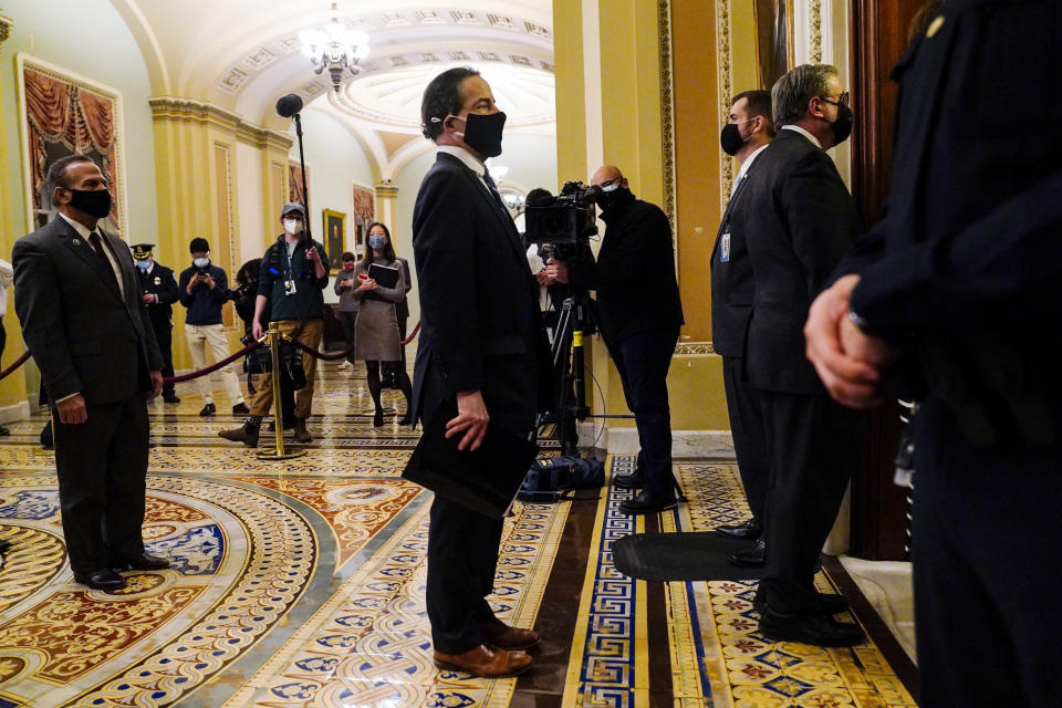 Democratic House impeachment managers stand before entering the Senate Chamber as they deliver to the Senate the article of impeachment alleging incitement of insurrection against former President Donald Trump, in Washington, Monday, Jan. 25, 2021. (Melina Mara/The Washington Post via AP, Pool)